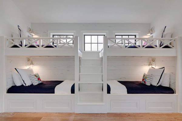 Built in bunk beds - what a fun idea and love the plank wood wall kellyelko.com