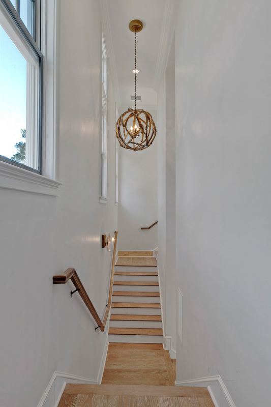 Driftwood orb chandelier in this beautiful coastal home - take the tour kellyelko.com