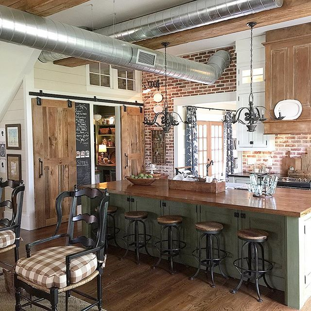 Love this farmhouse kitchen with exposed duct work and brick walls - part of this farmhouse tour kellyelko.com