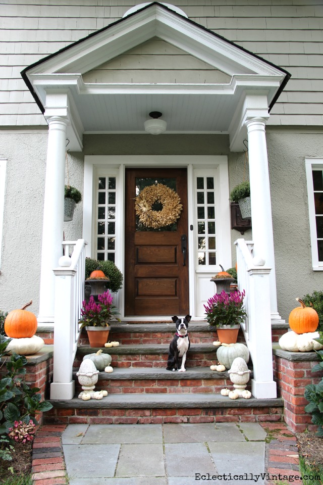 Love this natural fall porch - look at the stacked pumpkins! kellyelko.com