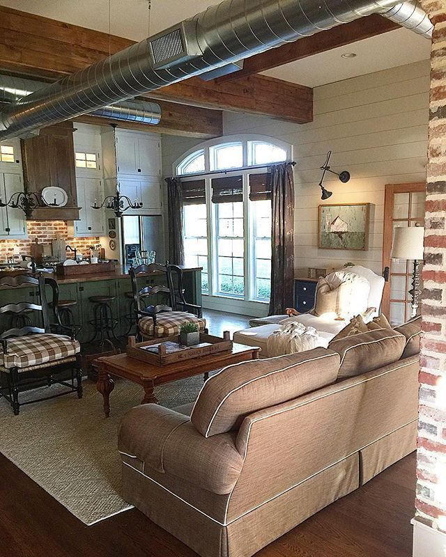 Farmhouse family room - love the exposed duct work and the 100 year old beams made from old barn floors kellyelko.com