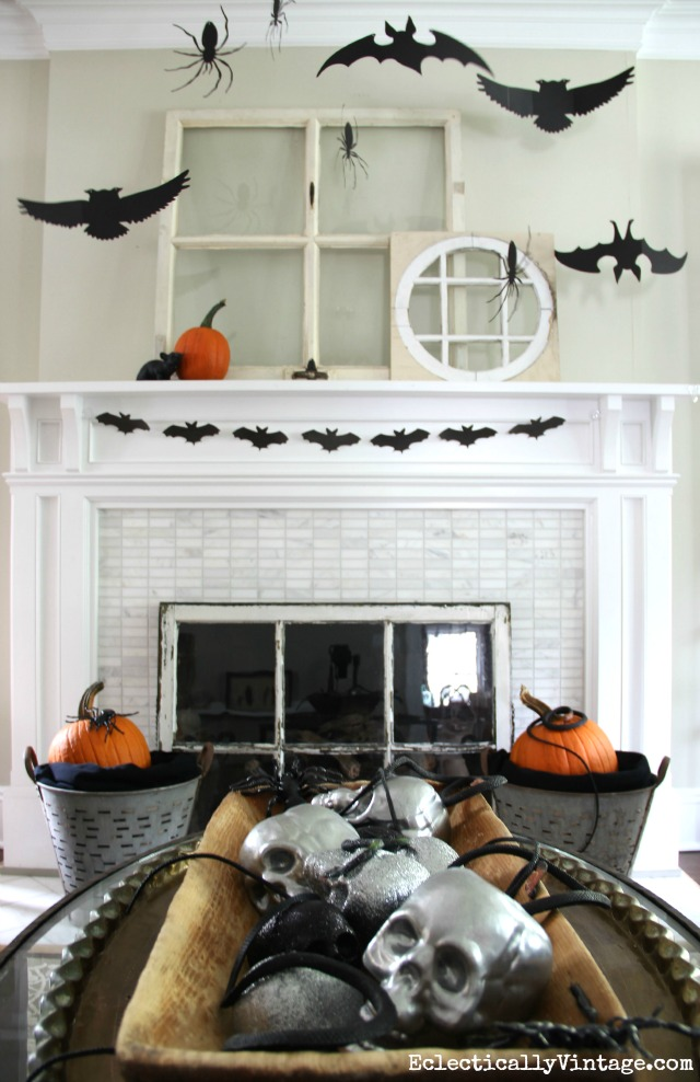 Love this black and white Halloween mantel and that big dough bowl of skulls! kellyelko.com