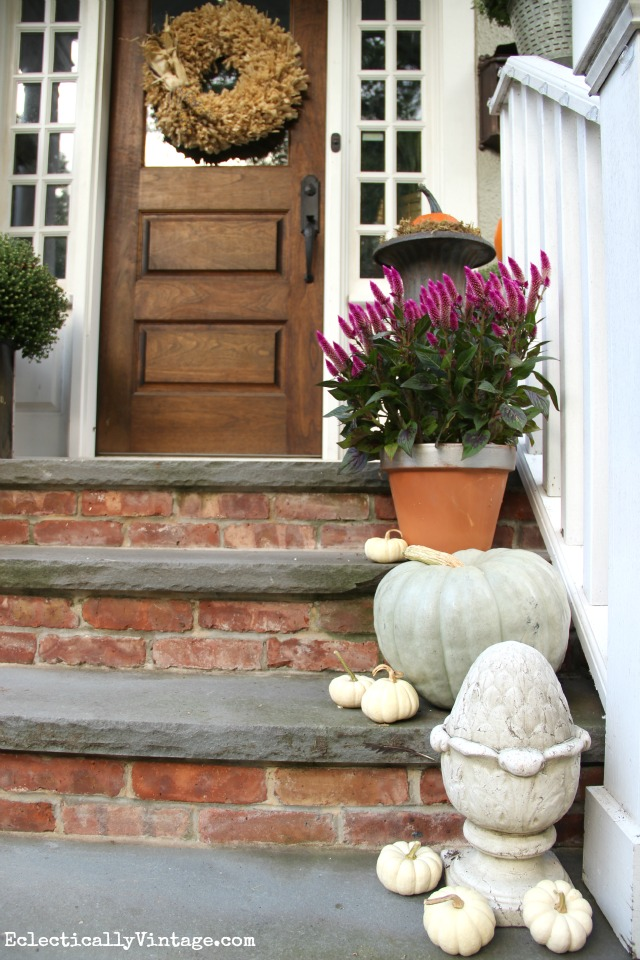Love the mini white pumpkins on this natural fall porch kellyelko.com