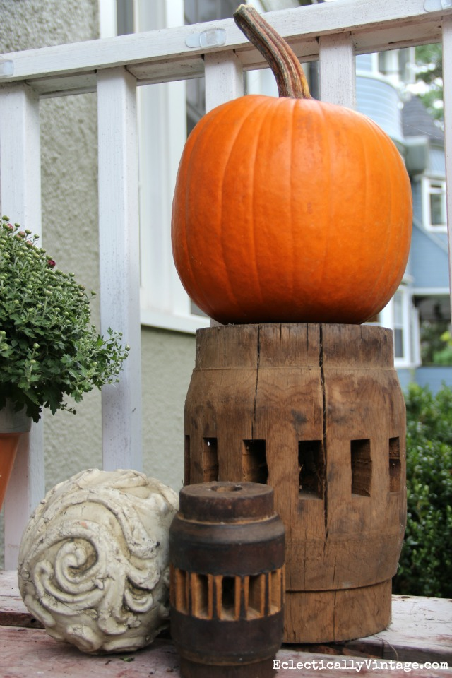 A few vintage finds and an orange pumpkin on a fall porch kellyelko.com