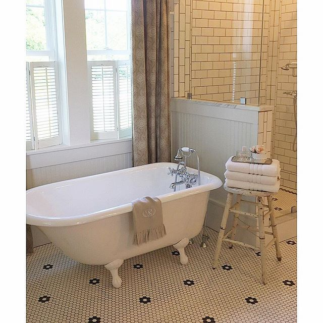 Vintage bathroom - love the black and white mosaic tile and the claw foot tub kellyelko.com