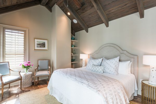 Love the dramatic wood beam ceiling and the upholstered headboard - take the full tour of this coastal home kellyelko.com