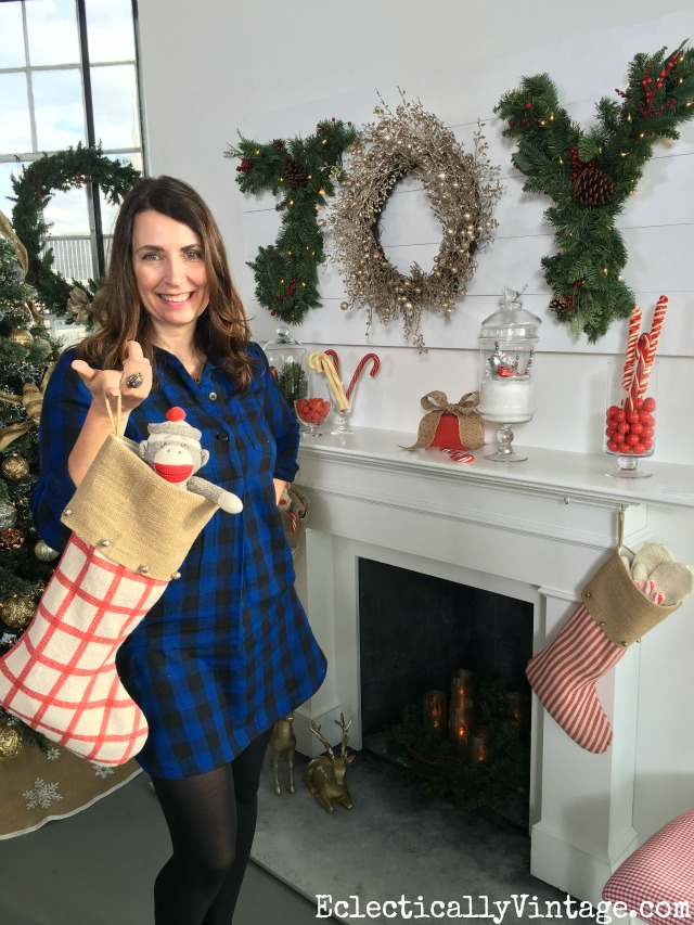 Love this festive mantel with DIY JOY sign and fun coordinating stockings kellyelko.com