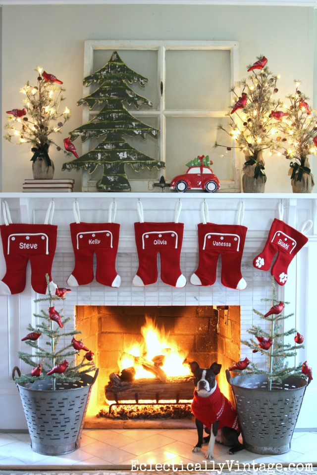 love this whimsical mantel with long john stockings the red car and tree theme is