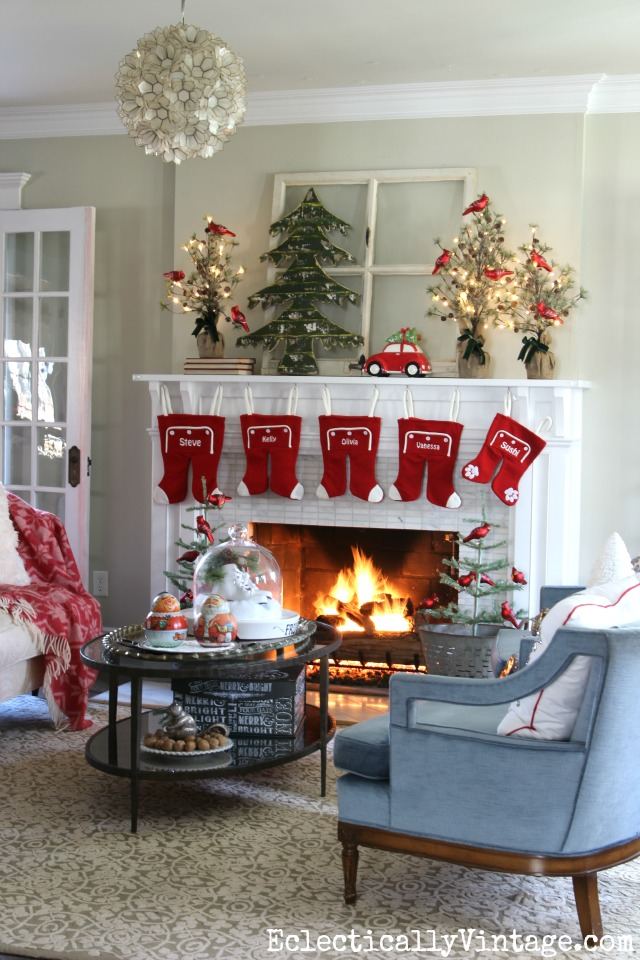 Love this festive Christmas mantel and the whimsical long john stockings kellyelko.com
