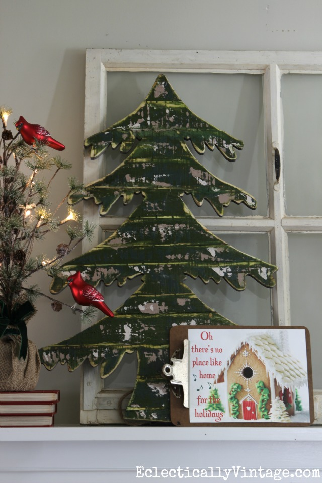 Love this mantel with the wood spruce tree and the FREE gingerbread house printable eclecticallyvintage.com