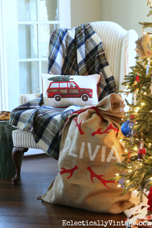Cozy Christmas chair - love the blue plaid throw and the car carrying tree pillow kellyelko.com