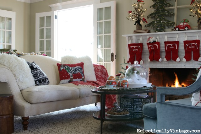 Christmas living room - love the festive pillows and whimsical mantel kellyelko.com