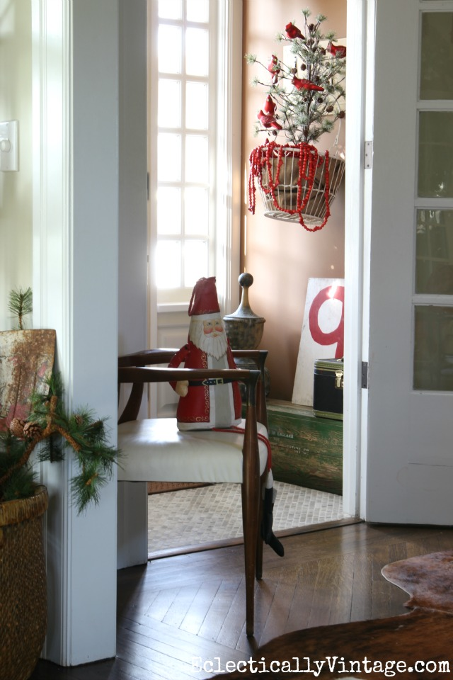 Welcoming Christmas foyer - love the tree in the metal basket kellyelko.com