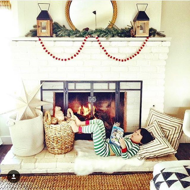 Love this minimal Christmas mantel and the pom pom garland