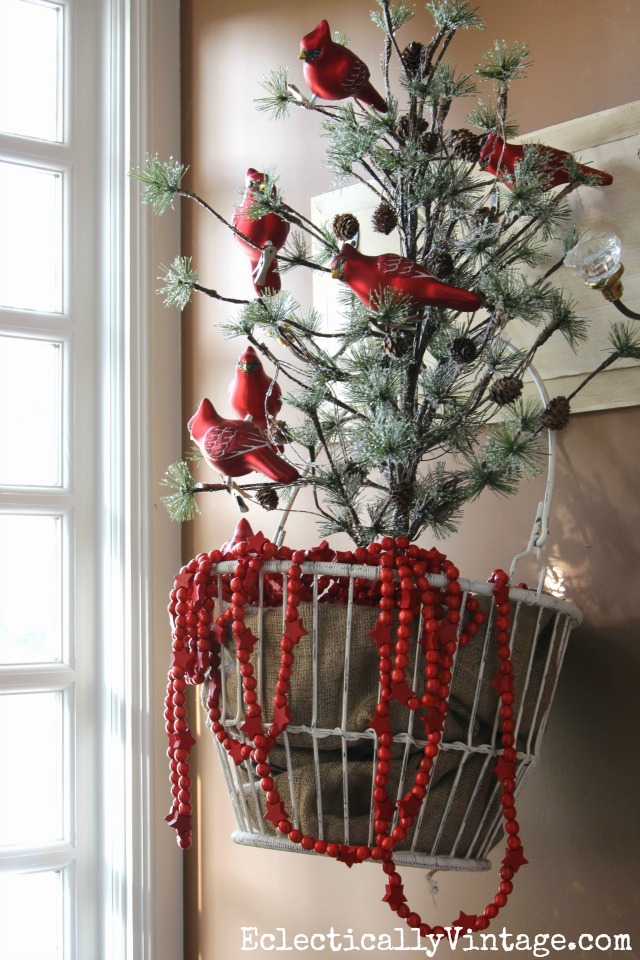 love the tree in the metal basket and the flock of red cardinal ornaments for christmas