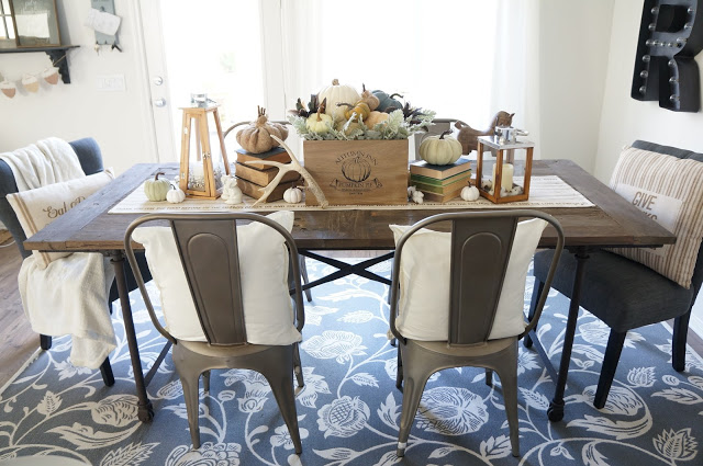 Love the floral rug in this cozy dining room kellyelko.com
