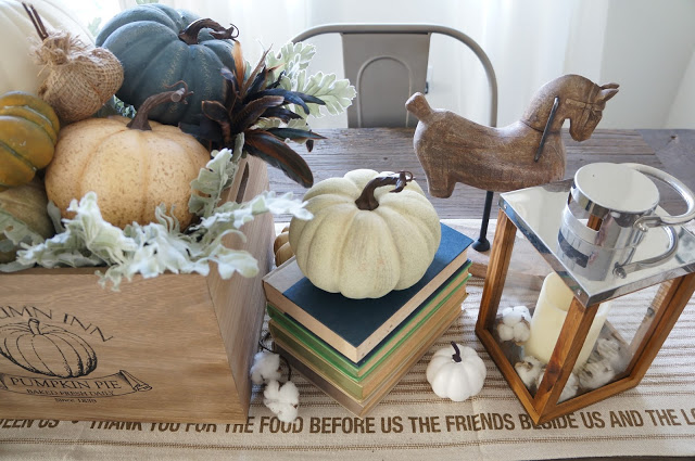 Beautiful fall tablescape - love the pumpkins on the stacked books kellyelko.com