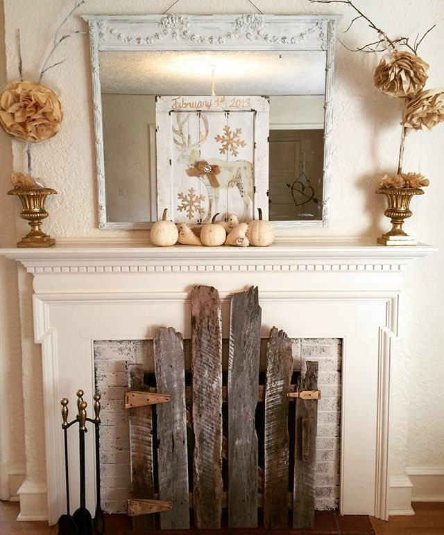 Love the old fence used as a fireplace screen!