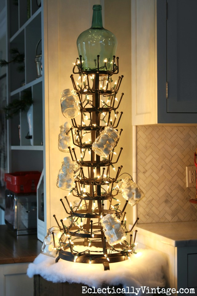What a fun idea for a kitchen Christmas tree! String some lights around a huge bottle drying rack! kellyelko.com