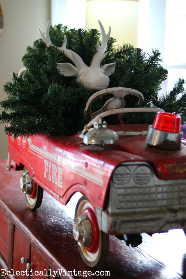 Cute! Vintage toy fire truck carrying a Christmas tree kellyelko.com