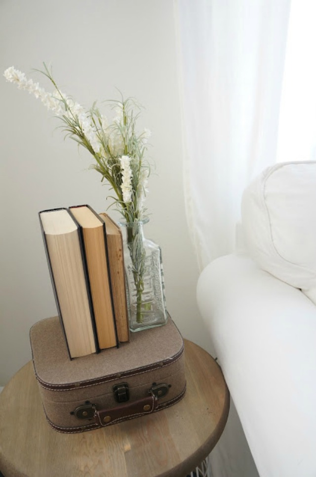 Vintage book display on a cute little suitcase - lots of affordable decorating ideas in this home tour kellyelko.com