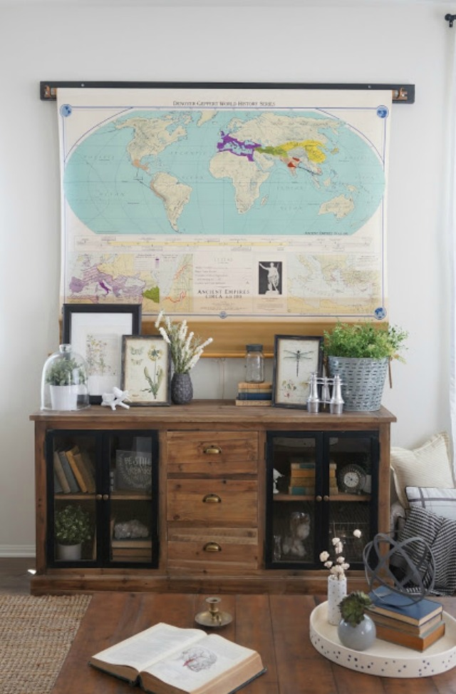 Love this idea - a vintage pull down map covers the TV kellyelko.com