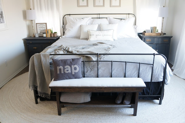 Love the iron bed and the antique chests used as nightstands kellyelko.com