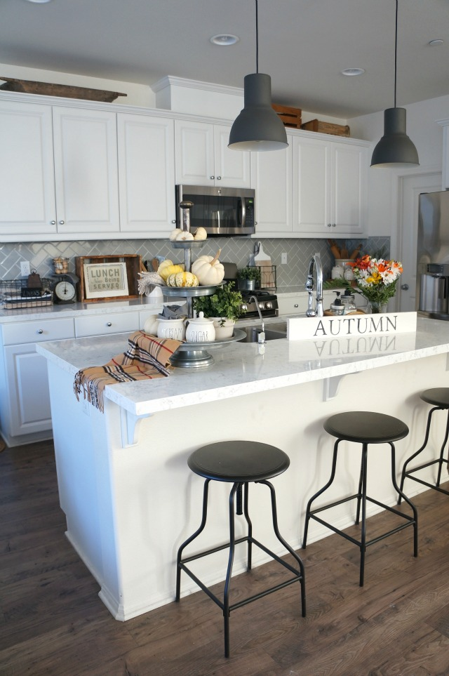 Eclectic Home Tour - love the industrial touches in this white kitchen. So many affordable decorating ideas kellyelko.com