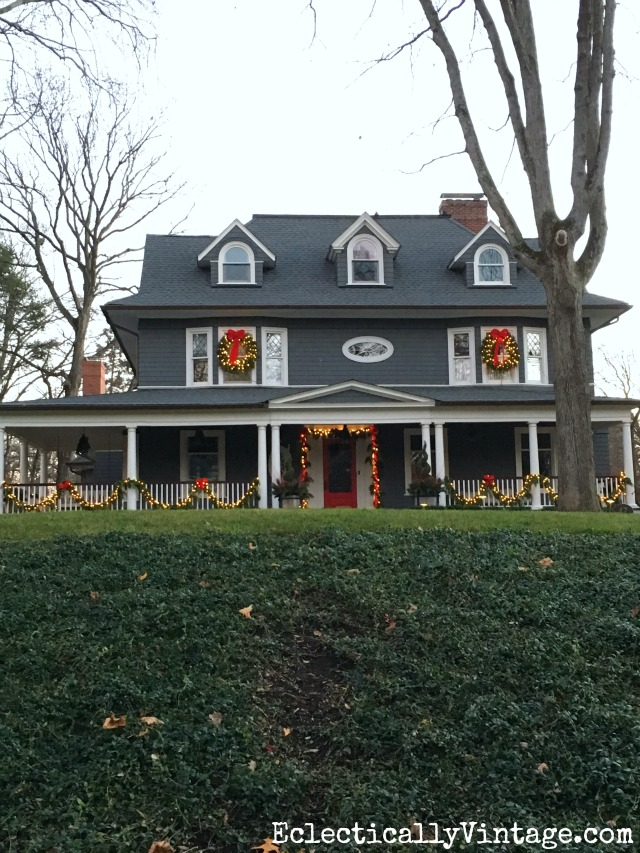 Christmas house - love the big porch with garland and red bows kellyelko.com