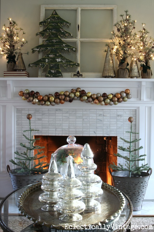 See how to make this festive ornament garland for your Christmas mantel kellyelko.com