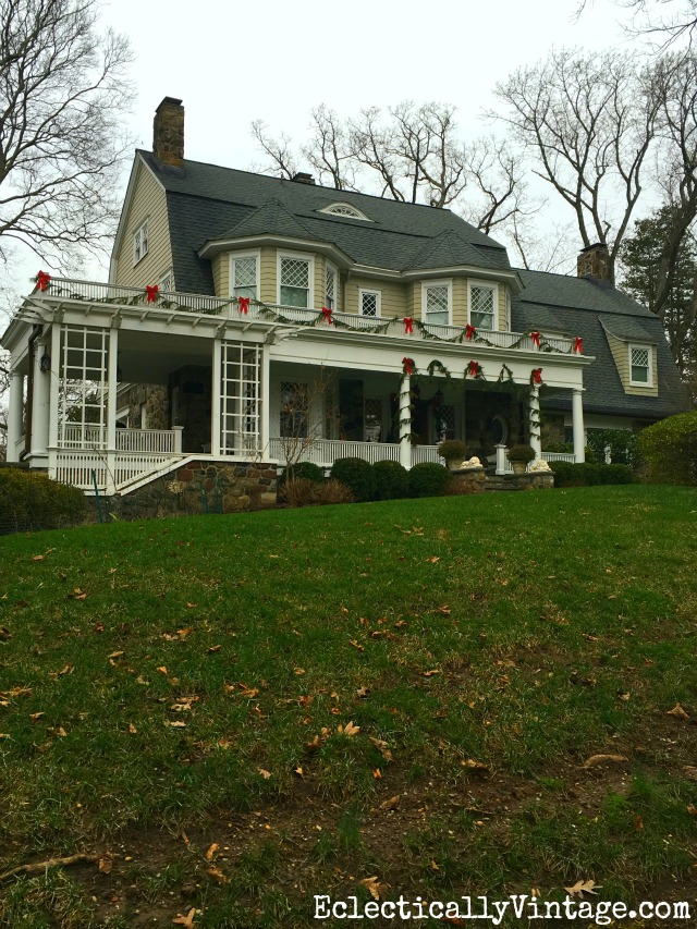 Love fresh garland and red bows on a Christmas house kellyelko.com