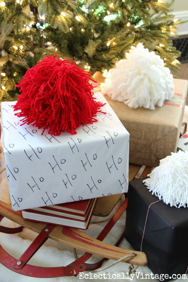 DIY Giant Pom Poms! Such a fun idea for gift wrap kellyelko.com