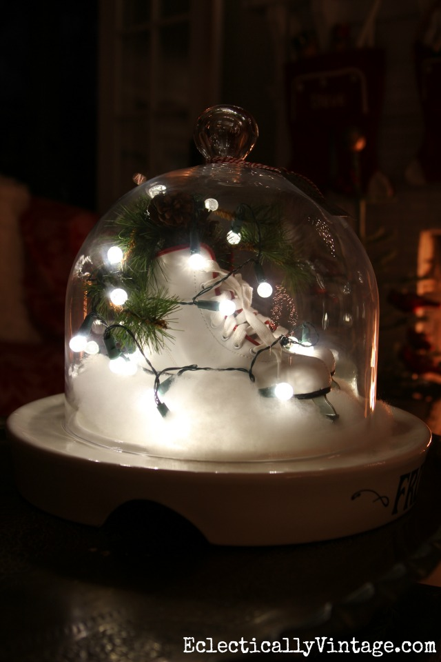 Ice skates and string lights under a cloche kellyelko.com