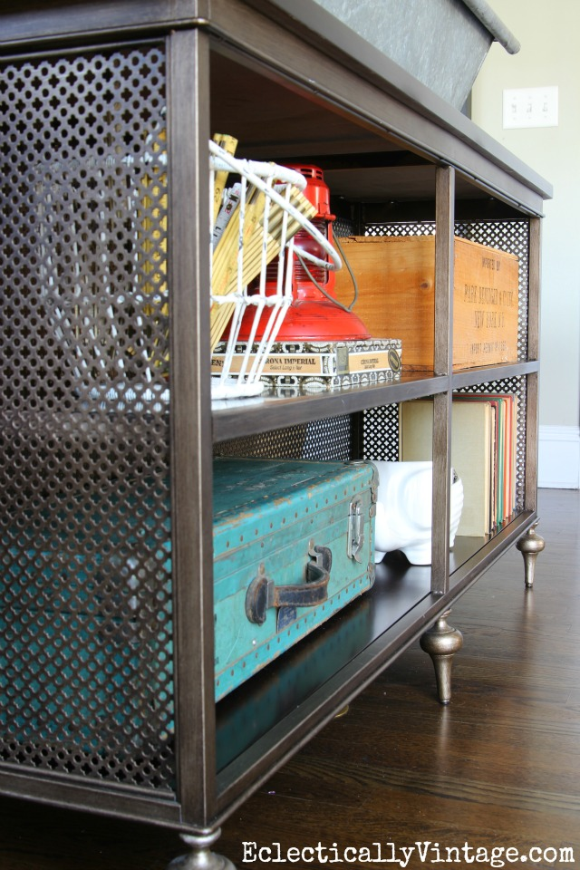 I love this console table with open metal fretwork and lots of fun vintage finds on display kellyelko.com