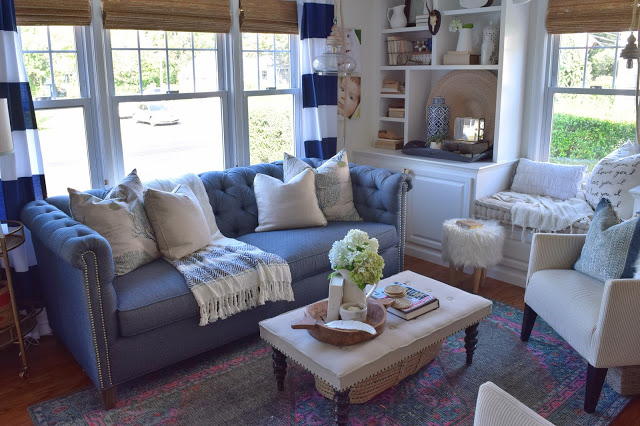 Love this cozy living room with blue Chesterfield sofa kellyelko.com