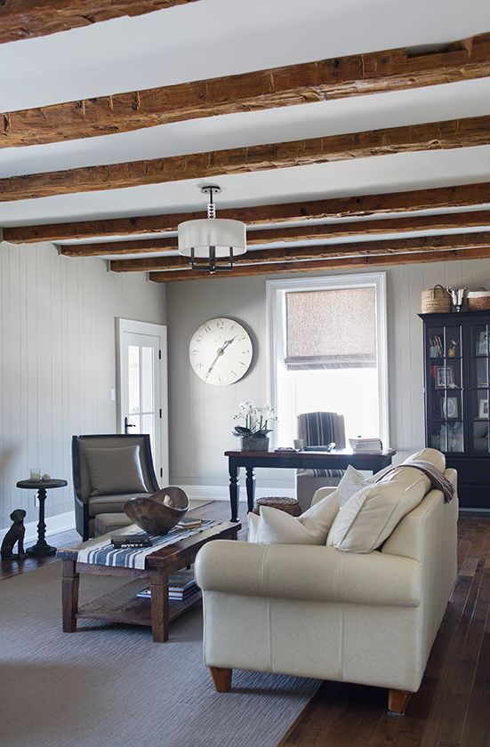 Rustic wood beams in this farmhouse family room kellyelko.com