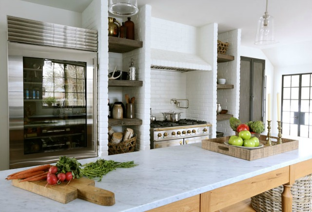 This kitchen is stunning from the French range to the Sub-Zero refrigerator to the rustic island with marble counters - tour this 1900's home kellyelko.com
