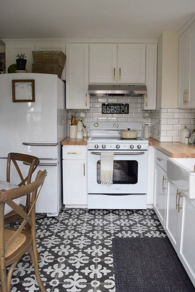 Beautiful small white kitchen with graphic impact from tile kellyelko.com