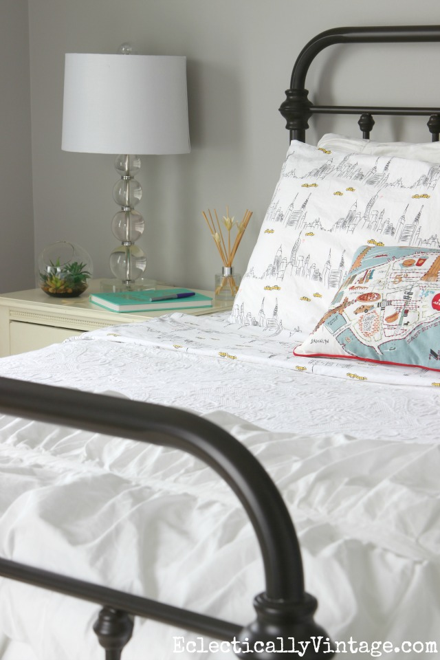 Love the metal bed with white bedding and glam crystal lamp kellyelko.com