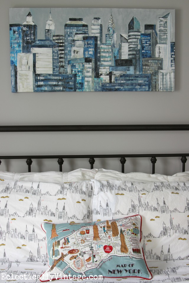 Love this gray paint color and the New York City themed art, sheets and pillow! kellyelko.com
