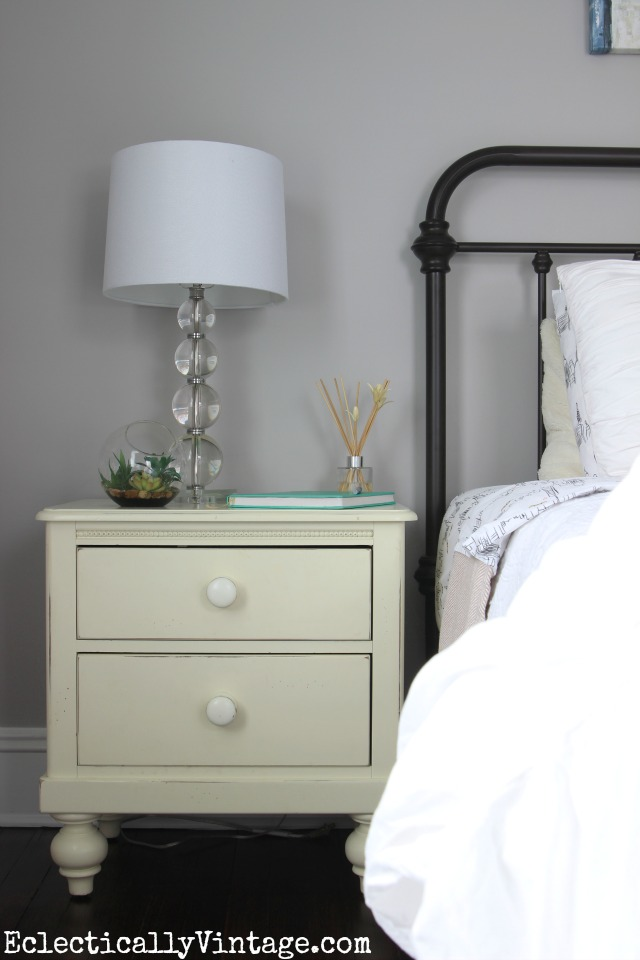 Love the gray walls and black vintage style bed kellyelko.com