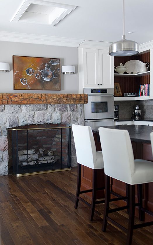 Love this farmhouse with a fireplace in the kitchen! The rustic beam mantel is stunning kellyelko.com