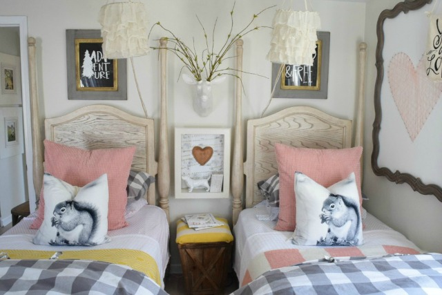 Cute girls bedroom with two twin beds - love the squirrel pillows kellyelko.com