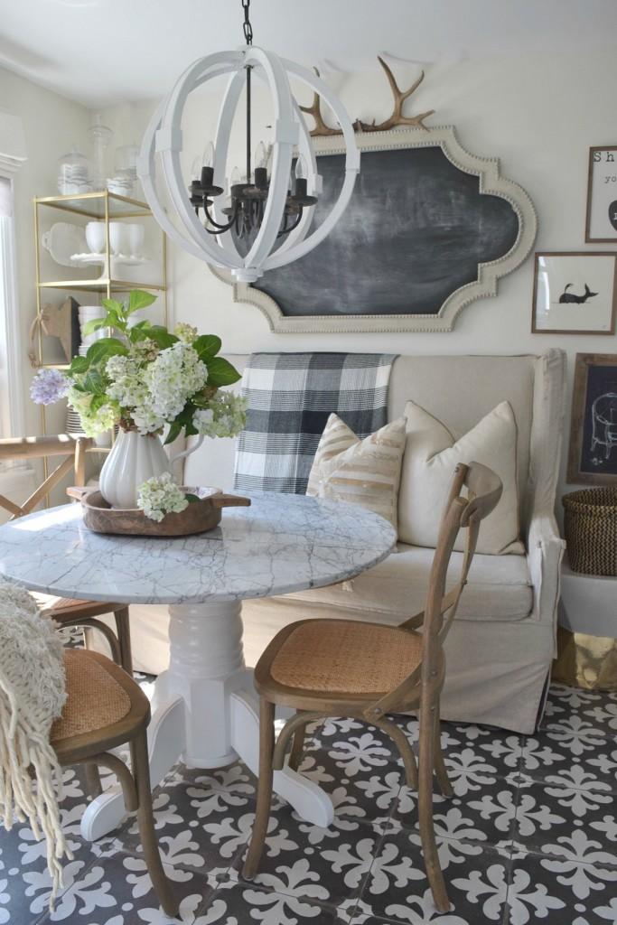 Love the graphic tile floor in this cozy kitchen kellyelko.com