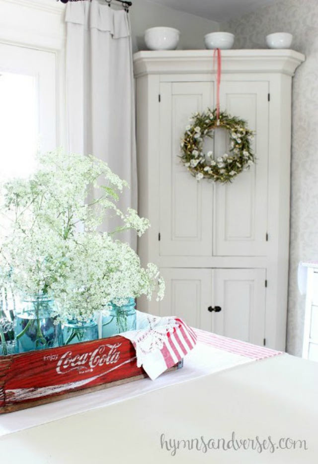 Old Coke crate filled with mason jars and flowers makes a great centerpiece kellyelko.com