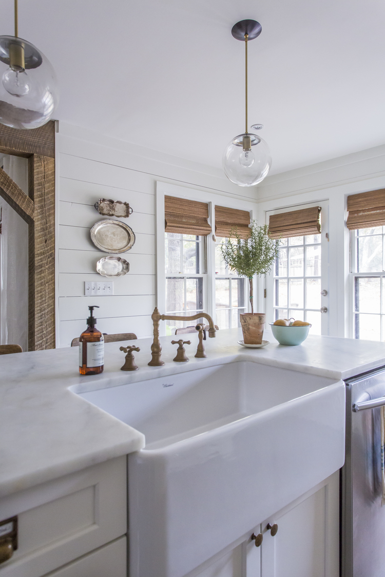 Love the unpolished brass faucet and farmhouse sink in this beautiful white kitchen kellyelko.com