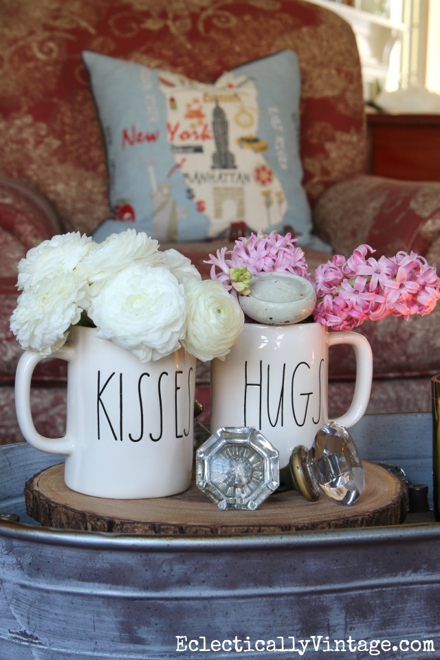 Simple Valentines Day -  how cute are these Valentine hugs and kisses mugs holding spring flowers kellyelko.com