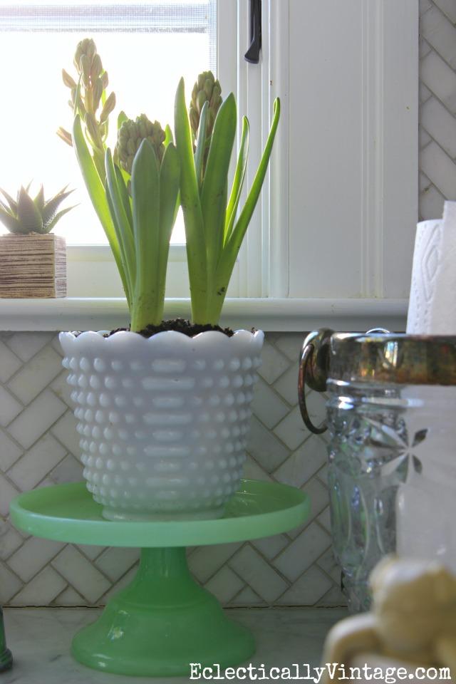 "Vintage milk glass vase on a new ""jadeite"" cake stand kellyelko.com"