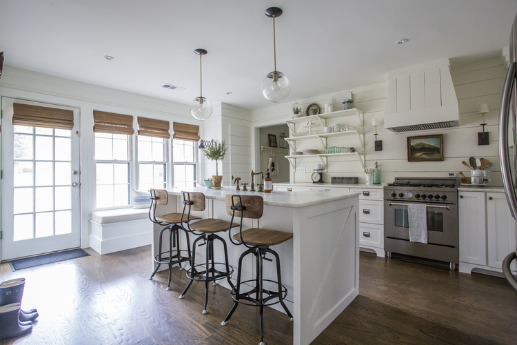 Love all the details in this white kitchen - the shiplap walls, open shelves, glass lighting and industrial barstools kellyelko.com