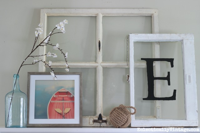 Love this mantel display - a couple of old windows with a colorful piece of art and add a nautical touch kellyelko.com